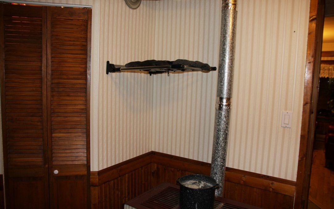 Drying rack over furnace